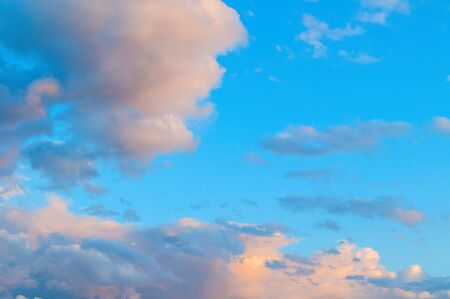 Sunset dramatic sky background - picturesque colorful clouds lit by sunlight. Vast sky landscape panoramic scene, colorful sky view in pastel tones
