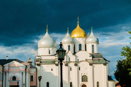 Veliky Novgorod, Russia. Saint Sophia Cathedral domes, closeup facade view of Veliky Novgorod landmark on the background of evening dramatic clouds Stock fotó