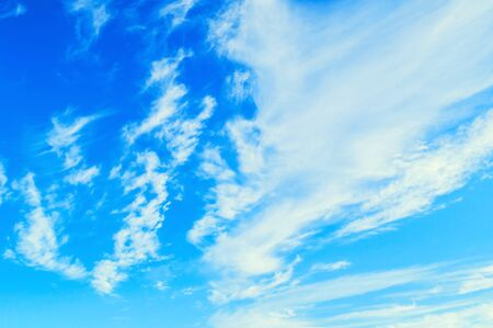Dramatic blue sky background. Picturesque colorful clouds lit by sunlight. Vast sky landscape panoramic scene - colorful sky view in bright tones