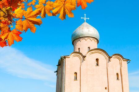 Veliky Novgorod, Russia. Saviour Church on Nereditsa - an orthodox church built in 1198, one of Russias oldest churches. Veliky novgorod landmark framed by autumn leaves