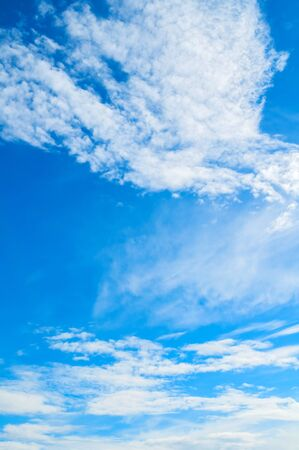 Dramatic blue sky background - picturesque colorful clouds lit by sunlight. Vast sky landscape panoramic scene. Colorful sky view in vivid tones Stock fotó