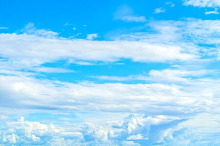 Blue dramatic sky background - picturesque colorful clouds lit by sunlight. Vast sky landscape panoramic scene, colorful sky in sunny weather