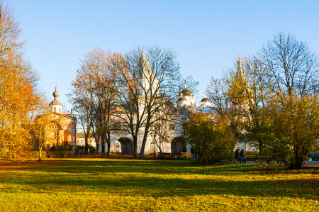 Veliky Novgorod, Russia - October 21, 2018. Paraskeva Pyatnitsa Church and Gate tower at Yaroslav Courtyard in Veliky Novgorod, Russia, autumn architecture view in sunny weather