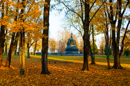 Veliky Novgorod, Russia - October 17, 2018. The bronze monument Millennium of Russia in autumn sunset and people walking in the autumn park in Veliky Novgorod, Russia. Autumn city sunny landscape Stock fotó - 129660430