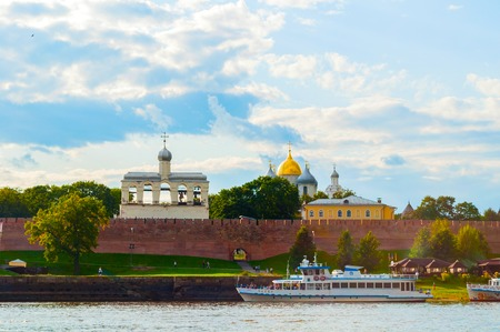 Veliky Novgorod,Russia-August 10, 2019. Veliky Novgorod Kremlin fortress and touristic sailboats at the pier at the Volkhov river. Travel landscape of Veliky Novgorod, Russia Sajtókép