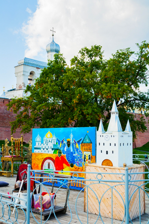 Veliky Novgorod,Russia-August 10, 2019. Belfry of St Sophia cathedral various touristic entertainment equipment on the foreground in Veliky Novgorod, Russia