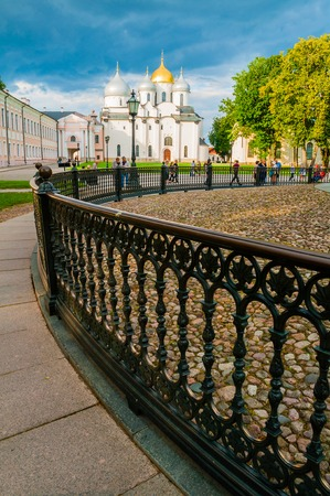 Veliky Novgorod,Russia - August 10, 2019. Saint Sophia Cathedral and wrought fence of Millennium of Russia monument. Veliky Novgorod landmarks on the background of dramatic clouds Sajtókép