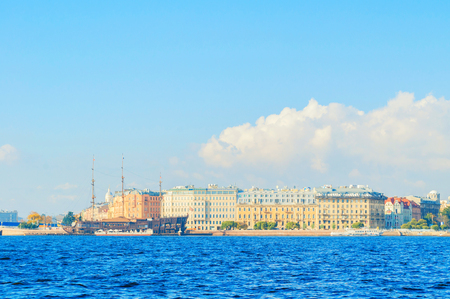 St Petersburg, Russia -October 3, 2016. Mytninskaya embankment and city buildings near the Neva river with Flying Dutchman - the restaurant on the water in St Petersburg, Russia