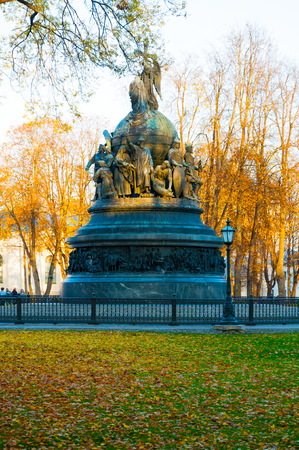 Veliky Novgorod, Russia - October 17, 2018. The bronze monument Millennium of Russia in the autumn park in Veliky Novgorod, Russia. City autumn landscape Sajtókép