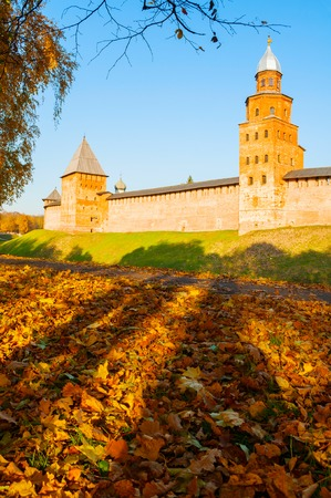 Veliky Novgorod, Russia. Towers of Veliky Novgorod Kremlin at autumn sunny day. Focus at the Kremlin tower. Autumn city landscape Sajtókép