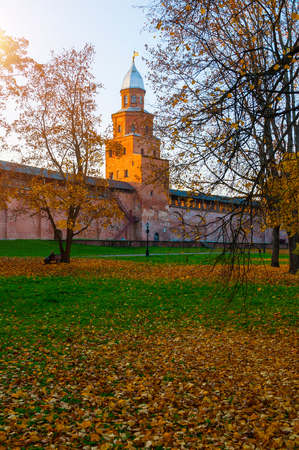 Veliky Novgorod, Russia. Kokui tower of Veliky Novgorod Kremlin at autumn sunny day. Focus at the Kremlin tower. Autumn city evening landscape