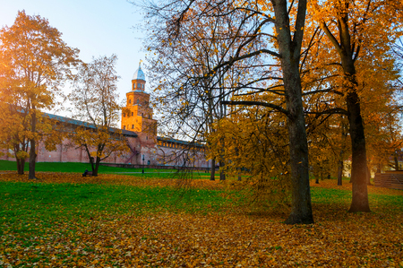 Veliky Novgorod, Russia. Kokui tower of Veliky Novgorod Kremlin at autumn sunny day. Focus at the Kremlin tower. Autumn city landscape Sajtókép