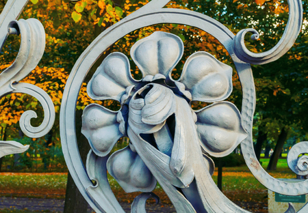 Autumn in St Petersburg - decorative detail in the form of flower at the fence of the Mikhailovsky Garden in St Petersburg, Russia. Autumn architecture view of St Petersburg landmark Sajtókép
