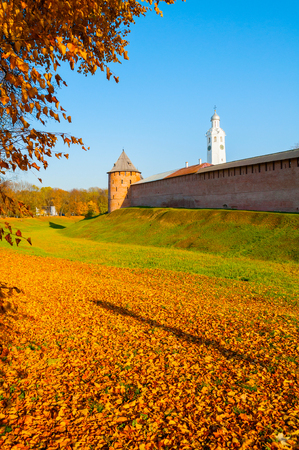 Veliky Novgorod, Russia. Fedor tower and clock tower of Veliky Novgorod Kremlin at autumn sunny afternoon. Focus at the Kremlin towers. Autumn city landscape