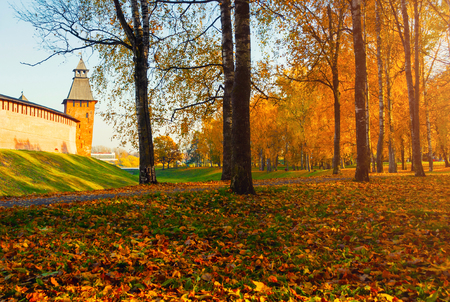 Veliky Novgorod, Russia. Savior Tower of Veliky Novgorod Kremlin at autumn sunny day. Focus at the Kremlin tower. Autumn city landscape