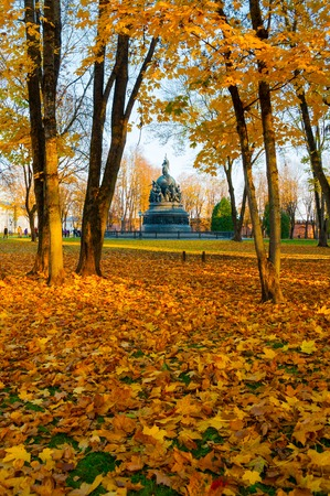 Veliky Novgorod, Russia - October 17, 2018. The bronze monument Millennium of Russia in autumn sunset and people walking in the autumn park in Veliky Novgorod, Russia. Autumn city landscape