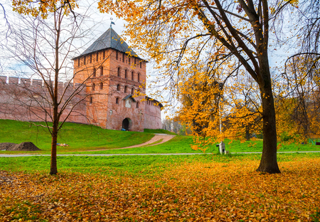 Veliky Novgorod, Russia. Vladimir tower of Veliky Novgorod Kremlin at autumn sunny day. Focus at the Kremlin tower. Autumn city landscape