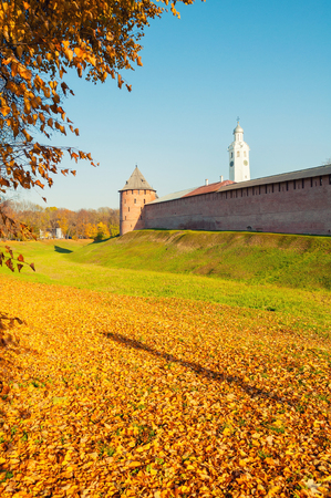 Veliky Novgorod, Russia. Fedor tower and clock tower of Veliky Novgorod Kremlin at autumn sunny day. Focus at the Kremlin towers. Autumn city landscape Sajtókép