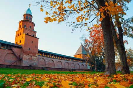 Veliky Novgorod, Russia. Towers of Veliky Novgorod Kremlin at autumn sunny day. Focus at the Kremlin tower. Autumn city evening landscape Stock fotó