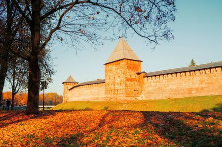 Veliky Novgorod, Russia. Chrysostom and Intercession Towers of Veliky Novgorod Kremlin at autumn sunny day. Focus at the Kremlin towers. Autumn city landscape