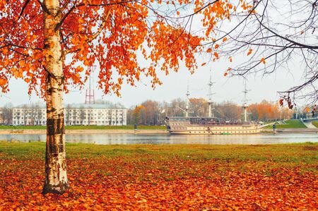 Veliky Novgorod, Russia - October 18, 2018. Frigate Flagship restaurant complex and water area of the Volkhov river in Veliky Novgorod, Russia. Autumn cloudy town landscape
