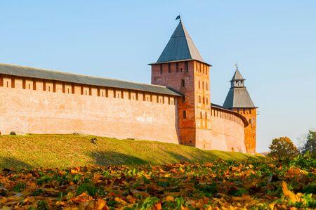 Veliky Novgorod, Russia. Towers of Veliky Novgorod Kremlin at autumn sunny day. Focus at the Kremlin towers. Autumn city landscape Stock fotó
