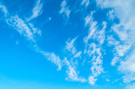Dramatic blue sky background. Picturesque colorful clouds lit by sunlight. Vast sky landscape panoramic scene. Colorful sky view in bright tones