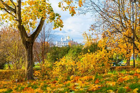 Veliky Novgorod, Russia. St Sophia Cathedral and bell tower in the Kremlin park in Novgorod, Russia - frame composition with autumn trees. Architecture sunny autumn landscape