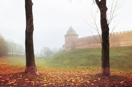 Veliky Novgorod, Russia. Fedor tower of Veliky Novgorod Kremlin at autumn foggy day. Focus at the Kremlin tower. Autumn city landscape