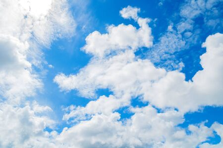 Blue sky background. Picturesque colorful clouds lit by sunlight. Vast sky landscape panoramic scene. Colorful sky view