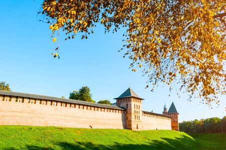 Veliky Novgorod, Russia. Chrysostom and Intercession Towers of Veliky Novgorod Kremlin at autumn sunny day. Focus at the Kremlin towers. Autumn evening city landscape