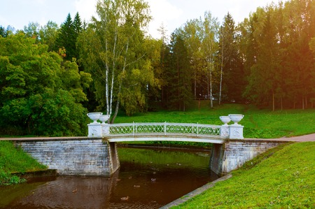 Pavlovsk, Russia - September 21, 2017. Cast-iron bridge across Slavyanka River in Pavlovsk, St Petersburg, Russia