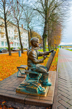 Veliky Novgorod, Russia - October 17, 2017. Sculpture of the painter boy at the embankment of the Volkhov river in autumn. Selective focus at the sculpture