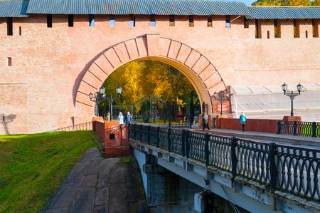Veliky Novgorod, Russia - October 10, 2017. Main entrance to Novgorod Kremlin and tourists walking along a viaduct in Veliky Novgorod, Russia Sajtókép