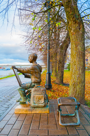 Veliky Novgorod, Russia - October 17, 2017. Sculpture of the painter boy at the embankment of the Volkhov river in autumn. Selective focus at the boy sculpture
