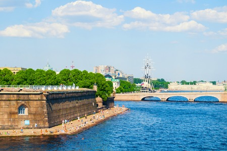 St Petersburg, Russia - June 6, 2019. The water area of the Neva river and Sovereign bastion near Peter and Paul fortress. Trinity bridge on the background Sajtókép