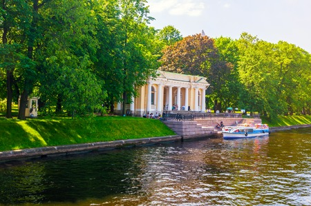 St Petersburg, Russia - June 6, 2019. Carlo Rossi Pavilion in the Michael Garden and the Moika river in St Petersburg, Russia