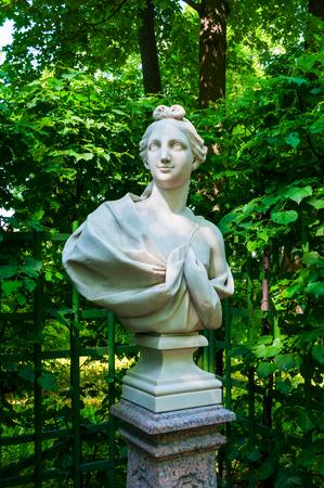 St Petersburg, Russia - June 6, 2019. The Sculpture of Young Man in the Summer Garden. Summer garden - the most famous garden of St Petersburg Russia Sajtókép