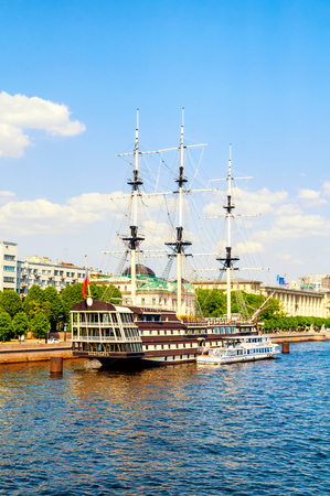 St Petersburg, Russia - June 6, 2019.Petrovsky embankment, Neva river and frigate Grace in St Petersburg, Russia.Frigate is a historical reconstruction of the three-Decker ships of the XVIII century
