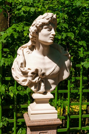 St Petersburg, Russia - June 6, 2019. The bust sculpture of Apollo, the Roman god. Summer garden - the most famous garden in St Petersburg Russia