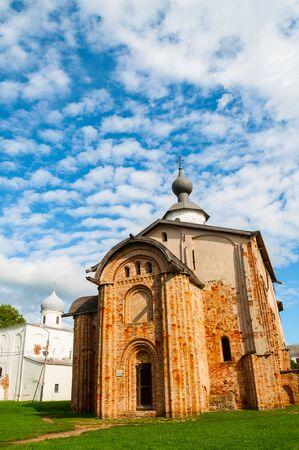 Veliky Novgorod, Russia. Paraskeva Pyatnitsa and Assumption Churches at Yaroslav Courtyard in Veliky Novgorod, Russia. Summer architecture landscape of Veliky Novgorod landmarks