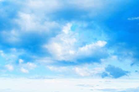 Blue sky background. Picturesque colorful clouds lit by sunlight. Vast sky landscape panoramic scene - colorful sky view in bright tones Stock fotó
