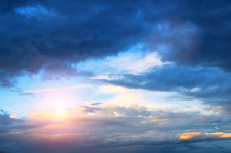 Sunset sky background. Sunset clouds lit by evening soft sunlight. Vast sky landscape panoramic scene - colorful sunset sky view Stock fotó