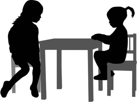 Meisjes zitten aan de tafel.