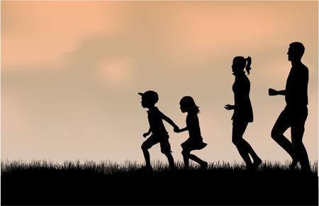 自然の中の家族のシルエット。