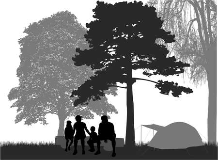 Family silhouette on vacation - camping.