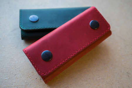 Red and green leather handmade key bag. leather keychain 스톡 콘텐츠