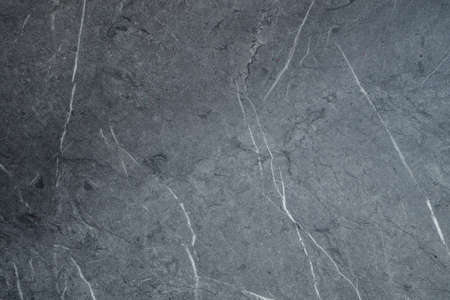 Gray scratched stone texture on background. Texture wallpaper