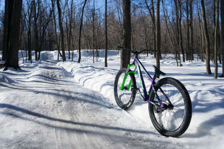 the bike stands in the background of dirt jumping in winter