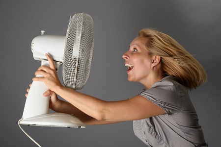Happy girl with a fan in hand Stock Photo